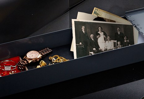 Custodian Vaults safety deposit box displaying photos, heirlooms, war medals